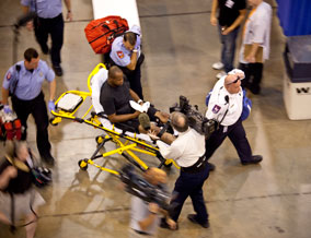 Filming a patient on a stretcher at the free clinic