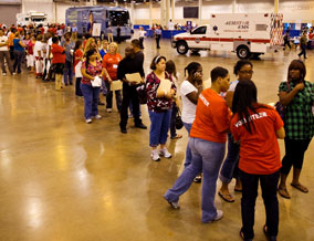Uninsured Texas residents stand in line at the free clinic