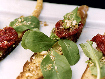 Oven-Dried-Tomato Bruschetta with Almonds and Arugula