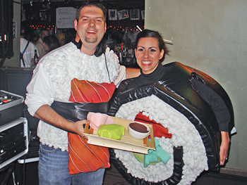 Estela and her husband dressed as sushi rolls.