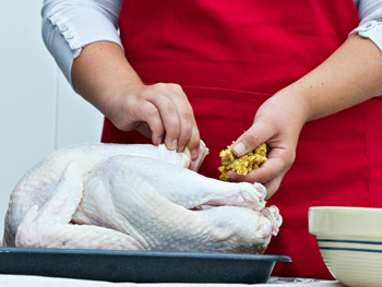 Woman fixing whole chicken