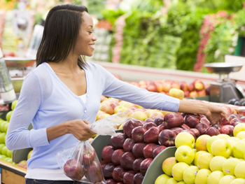 Woman picking out fruit at the supermarket
