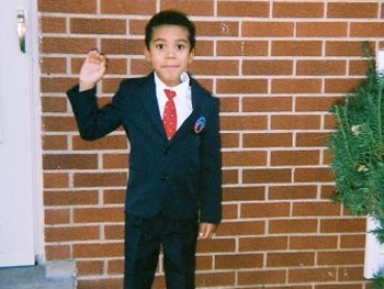 Little boy dressed as President Barack Obama