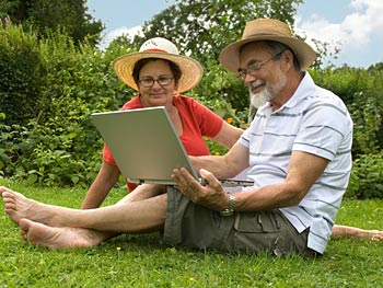 Couple in the garden with a laptop