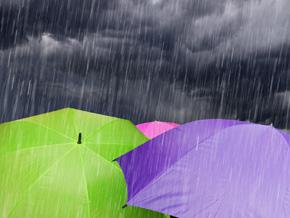 Umbrellas in stormy weather