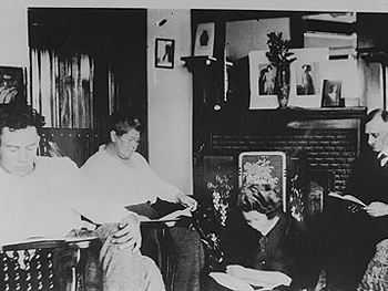 Steinbeck as a young man reading with his family.