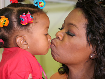 Oprah bonds with a child.