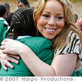 Mariah Carey hugs a student at Oprah's Leadership Academy South Africa