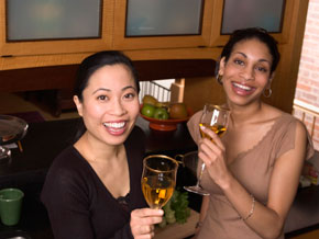 Two women at a home bar