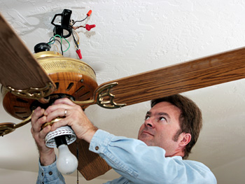 Man repairing a ceiling fan