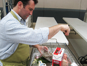 Adam Perry Lang seasoning a rib eye steak