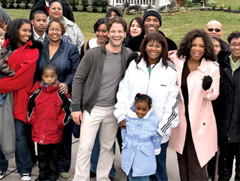 Oprah and Nate celebrate with the families who received new homes.