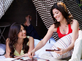 Ariel Ashe and Jennifer Carpenter play Scrabble.