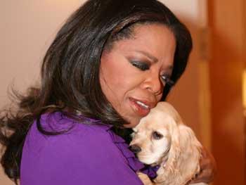 Oprah hugs Sadie.