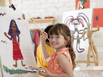 A mother and her daughters create crafts as a family.