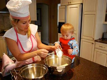 Maria and her son bake cookies.