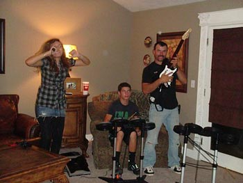 Brittini's family plays Rock Band.