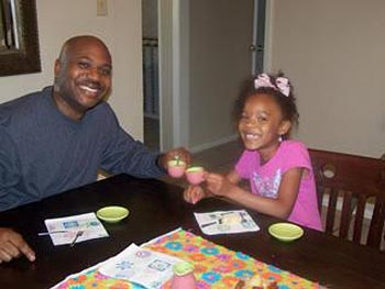 Tameka's husband and daughter have tea time.