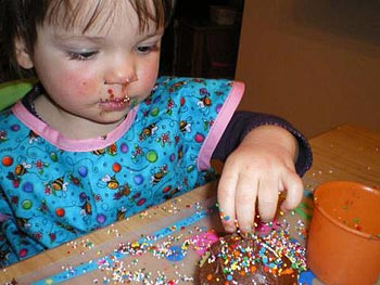 Sheila's daughter decorates a cupcake.