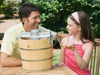 Dad and daughter making ice cream