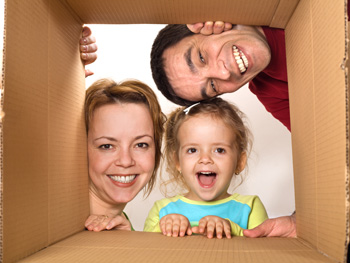 Family looking into box