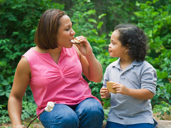 Mother and daughter eating s'mores