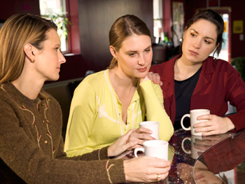 Sad woman talking with friends