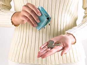 Woman with coins in hand