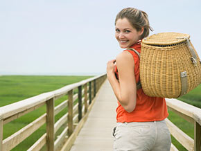 Woman with picnic backpack