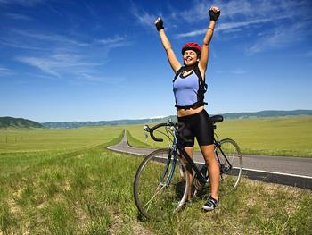 Happy woman riding bike