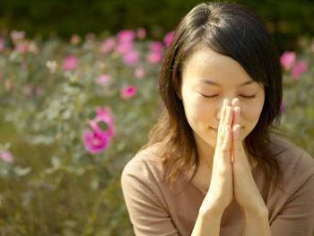 Woman affirming her faith