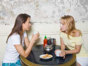Women having serious conversation