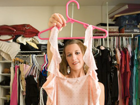 Woman searching through her closet