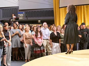 Oprah talks to the audience.