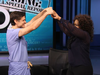 Dr. Oz and Oprah bump fists.