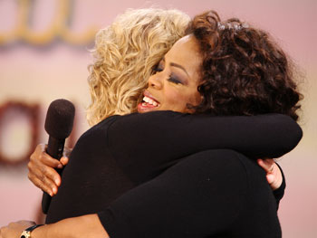 Elizabeth Gilbert gives Oprah a big hug.