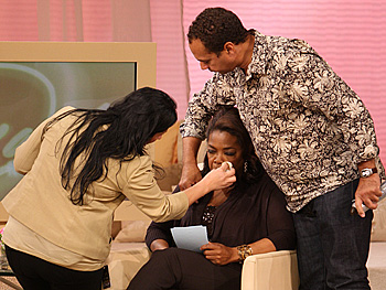 Oprah gets hair and makeup touch-ups.