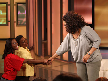 Oprah chats with audience members.