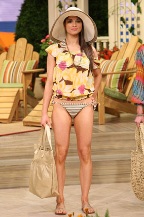 A woman models a beach look for a woman in her 20s.