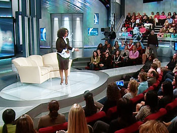 Oprah greets the audience.