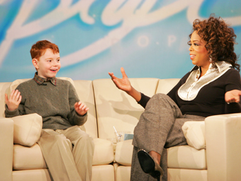 Daniel Cook and Oprah reflect on a job well done.
