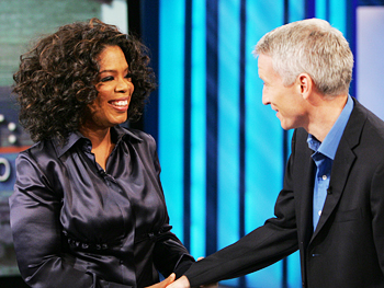 Oprah greets Anderson Cooper.