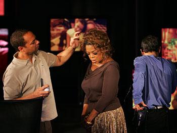 Oprah gets a last-minute spritz.