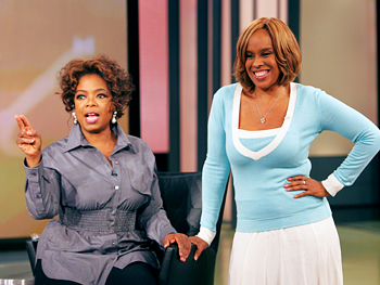 Oprah and Gayle greet their look-alikes.