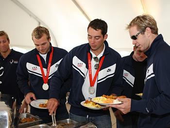 The water polo team eats breakfast.