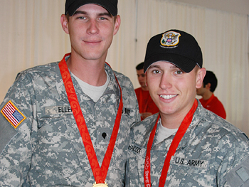 Shooting team members Walton Eller and Vincent Hancock take a moment to celebrate their gold medals.