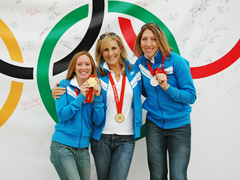Women's rowing team members Mary Whipple, Erin Carfaro and Michelle Guerette say cheese.