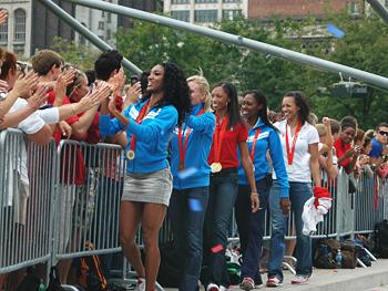 Track team members greet fans.