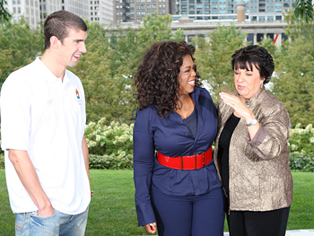 Oprah talks with Debbie and Michael Phelps.