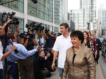 Michael Phelps and his mother, Debbie, greet the press line.